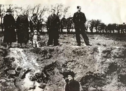 From Linda Waite - Bomb hole - 8.4.1943 - in field next to Well House. Linda's granny Moffat next to her mum and brother Norman